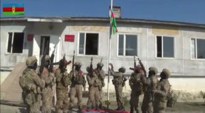 Azerbaijani flag raised up in center of liberated from occupation Fuzuli city
